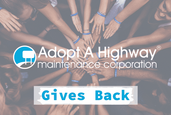 blue and white adopt a a highway gives back logo with cheering hands in a huddled as the background image
