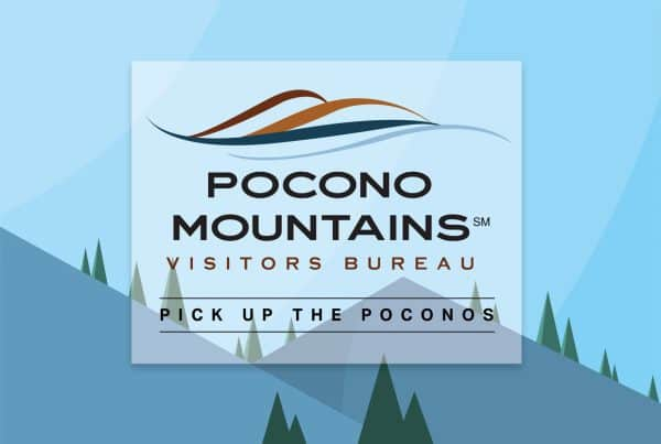 Pocono mountains visitor bureau logo with mountains and trees