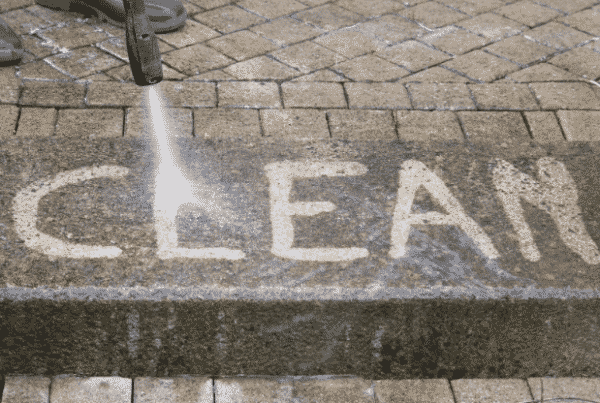 power washed side walk spelling out clean